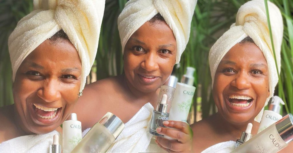 Black woman with turban and daily skincare routine products