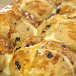 Vegan hot cross buns An Easter favorite, indulge yourself with some lovely, sticky vegan hot cross buns. A hot cross bun is a spiced sweet bun made with raisins that are marked with a cross on the top. Traditionally, they are eaten on Good Friday. Serve these fresh from the oven with some butter and jam. Simplicity at its best.
