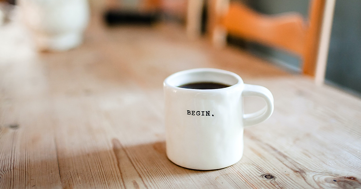 coffee cup with the word begin and start a business