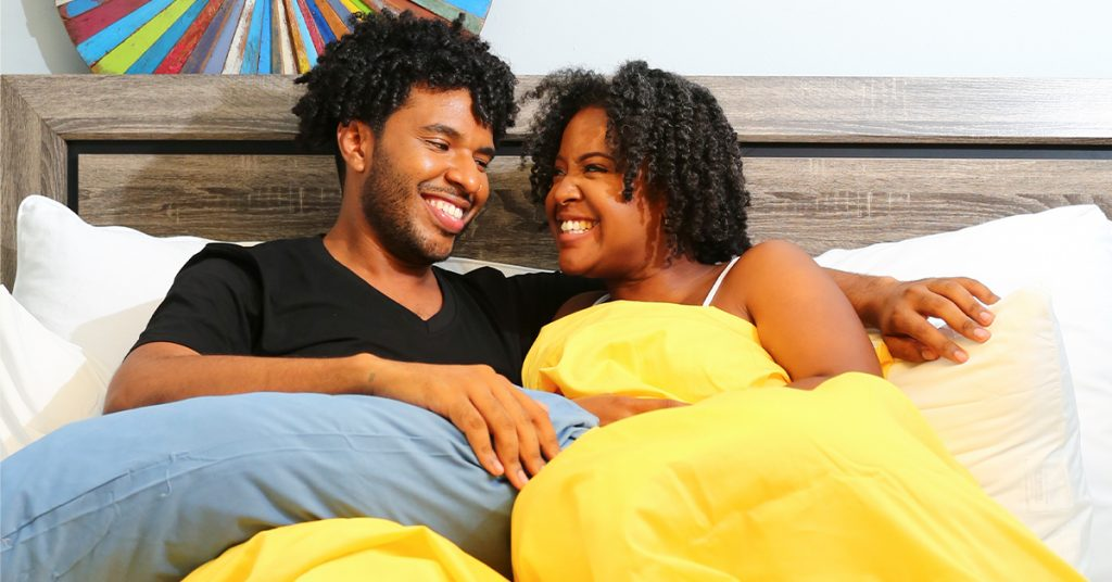 A couple in bed on a good mattress