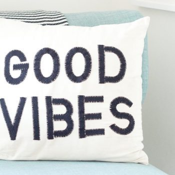 Good vibes pillow on couch to illustrate the comfort a good marketing plan will provide