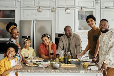 family around kitchen. food in front